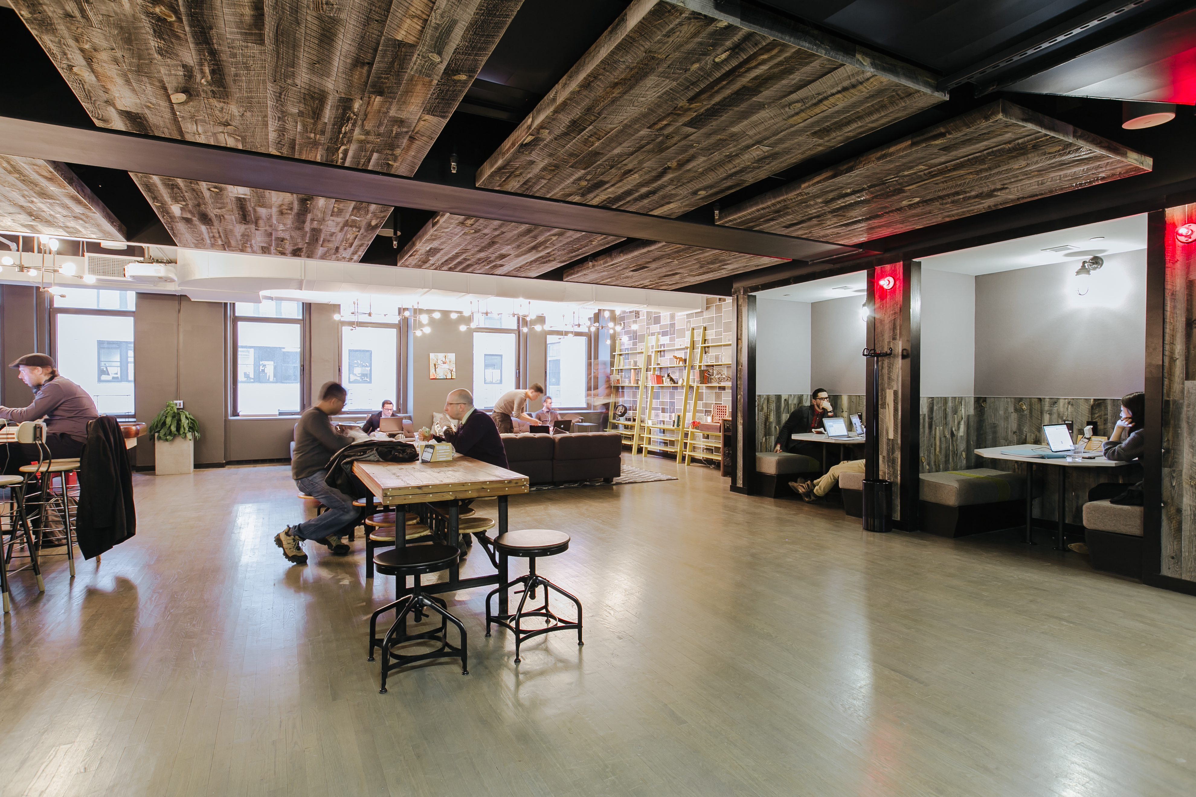 Coworking office space in new york city wework charging bull for Office design works